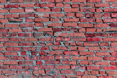 quantities: brickwork of the cracked and weathered stained rough brick. Art edition. Pink brick.