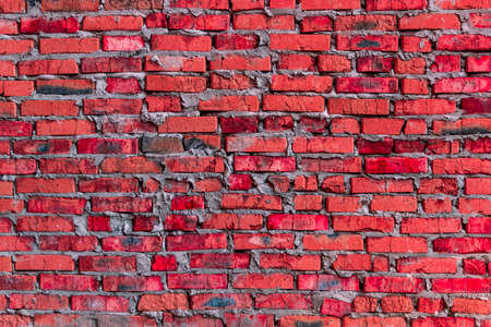 quantities: brickwork of the cracked and weathered stained rough brick. Art edition. Red brick Stock Photo