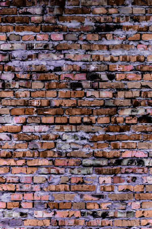 Background and texture of the brickwork of the colored bricks. photo