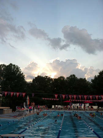 An evening swim practice with a pretty sky at Lake Monticello