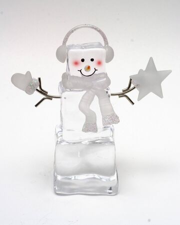 mitten: Ice cube snowman with star and mitten Stock Photo