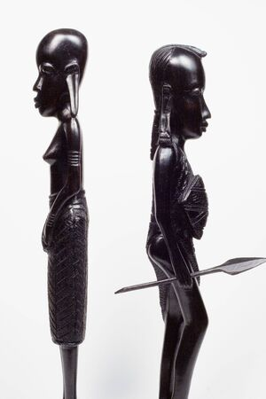 African woodcarvings of a woman and a warrior fighting Stock Photo
