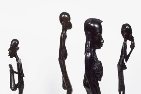 African woodcarvings showing one who dares to be different from the rest