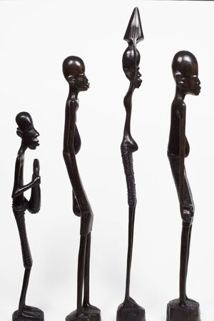 African woodcarvings depicting a group of men standing in line
