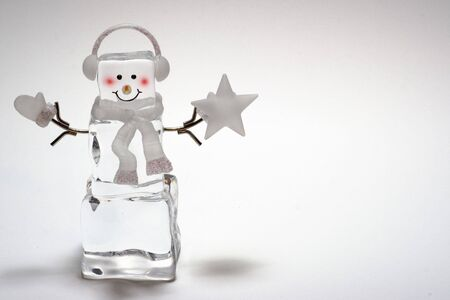 Ice cube snowman with star and mitten Фото со стока