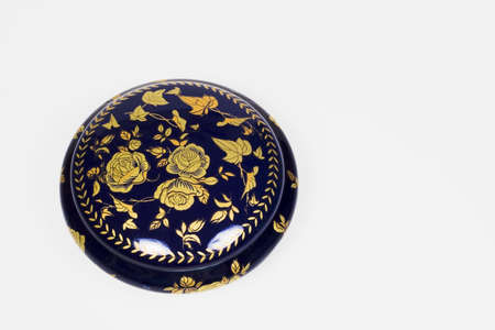 Blue and gold Chinese pot decorated with a flower design and a lid Stock Photo