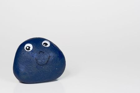 A blue pet rock Фото со стока