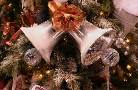 Silver bells on Christmas tree photo
