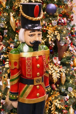 christmas military: Nutcracker ornament next to Christmas tree