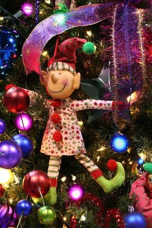 trimmings: Elf ornament on Christmas tree Stock Photo