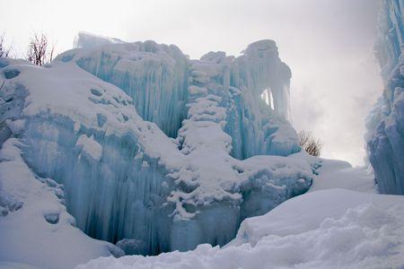 Frozen blue colored fountain that looks like a small glacier.