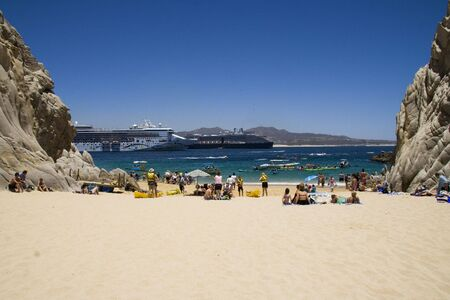 backgraound: People on Lovers Beach and cruise ships in the backgraound