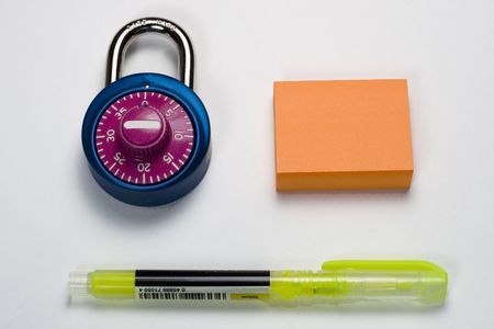 combination: Combination lock, sticky notes, and highlighter. Stock Photo