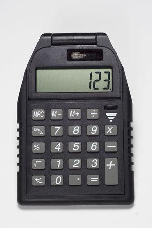 computations: Solar powered black calculator Stock Photo