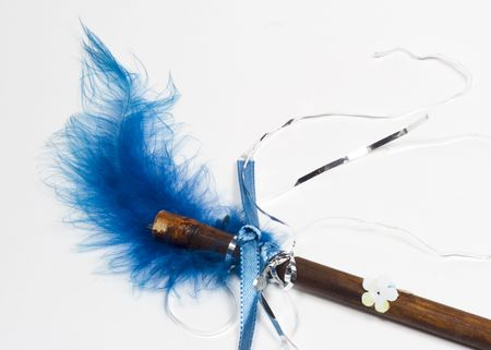 Homemade magic wand with blue feather Imagens