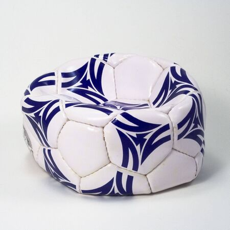 flattened: Flattened white and blue soccer ball