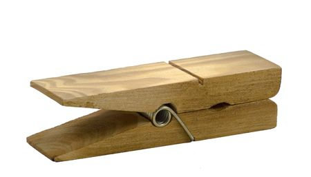 Large, old-style wooden clothespin with metal spring