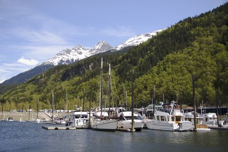 Boats docked ready for fishing and tourists in Skagway; Alaska Фото со стока