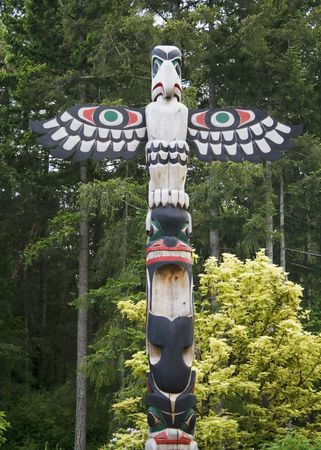 the totem pole: Bird totem pole  in Butchart Gardens, Victoria, British Columbia, Canada