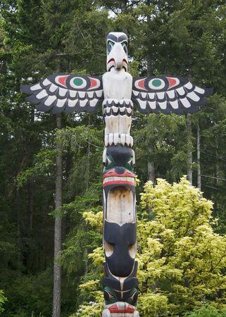 Bird totem pole  in Butchart Gardens, Victoria, British Columbia, Canada