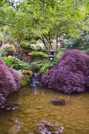 Beautiful and colorful lowers around pond in Butchart Gardens, Victoria, British Columbia, Canada