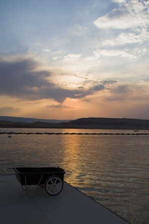 glen: Sunset at Lake Powell water and desert area in Glen Canyon National Recreation Area Utah