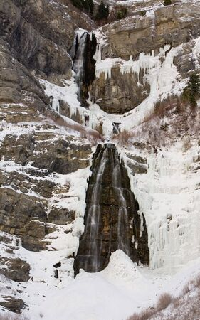 Partially frozen Bridal Veil Falls in Provo Canyon, Utah, United States