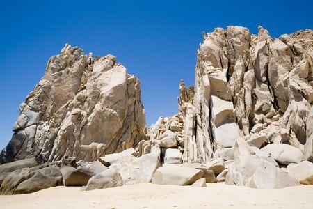 美しい水着用と頑丈なを探して岩付近のカボ San Lucas、メキシコ 写真素材