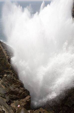 blowhole: The La Bufadora Blowhole in Ensenada, Baja California, Mexico that sprays water up to 70 feet into the air. Stock Photo