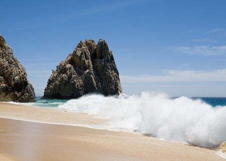 Pacific Ocean crashing against rocks at Divorce Beach near Cabo San Lucas, Mexico