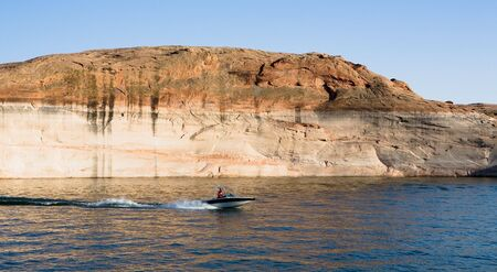 lake powell: Boat racing through the water at Lake Powell in Glen Canyon National Recreation Area, Utah Stock Photo