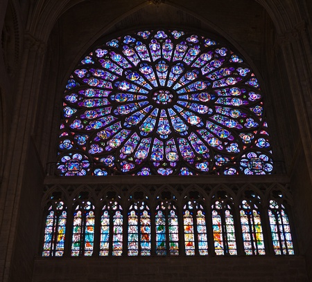 South Rose stained glass window inside Notre Dame Cathedral in Paris France Редакционное
