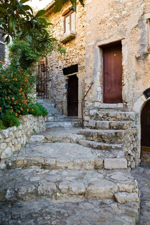 Steps on a street and doors in the medieval city of Exe, France, which is a fortress, built on cliff-side hill Reklamní fotografie