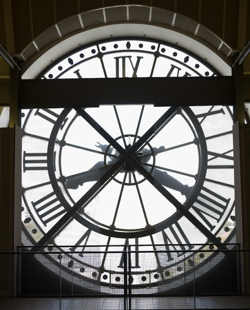 clock: Extremely large, clock visible from the outside of the Musee dOrsay Museum in Paris, France Stock Photo