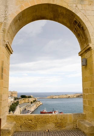 Archway looking out to the Mediterranean port of Valetta, on Malta  island