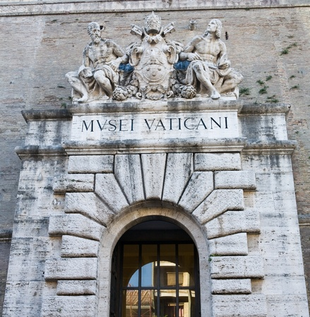 The historic Vatican City Museum entrance sign and stone wall surrounding the city