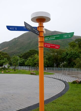 Sign on Lantau Island, Hong Kong that indicates the distance from that point to various locations in the world photo