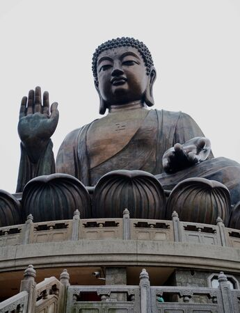 Giant sitting Buddha statue at Po Lin Monastery on Lantau Island, Hong Kong during a rain shower
