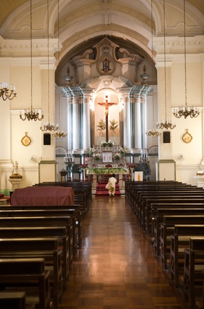 catholic church: Man kneeling at an alter in a Catholic church and praying to give thanks or ask for forgiveness