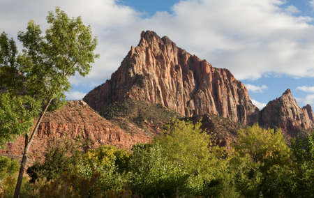 a watchman: The Watchman mountain in Zion National Park, Utah, United States at sunset in autumn with clouds in the sky