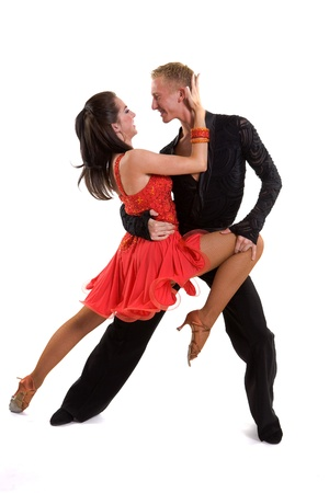 Young ballroom dancers in formal costumes posing against a solid background in a studio Stock Photo - 9621491