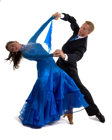 Young ballroom dancers in formal costumes posing against a solid background in a studio Stock Photo - 9621447