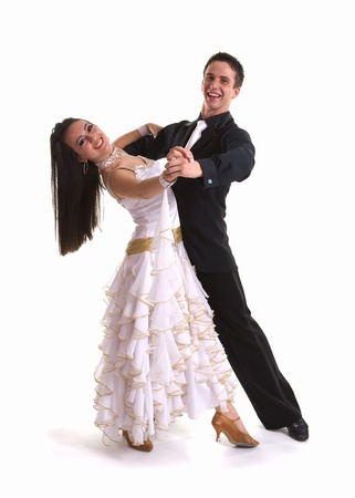 Young ballroom dancers in formal costumes posing against a solid background in a studio Stock Photo - 9621448