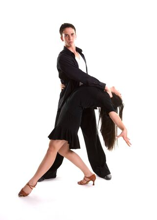 Young ballroom dancers in formal costumes posing against a solid background in a studio Stock Photo - 9621429