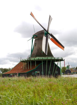 dutch: Authenticate Dutch windmills in the countryside at Kinderdijk outside of Amsterdam, The Netherlands