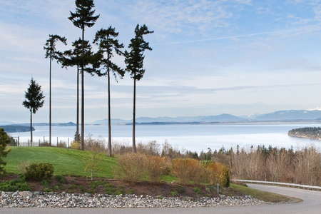 Puget Sound from Camino Island in the Seattle Washington area with mountains in the background Stock Photo - 17975375