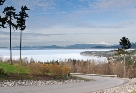 Puget Sound from Camino Island in the Seattle Washington area with mountains in the background Stock Photo - 17975373