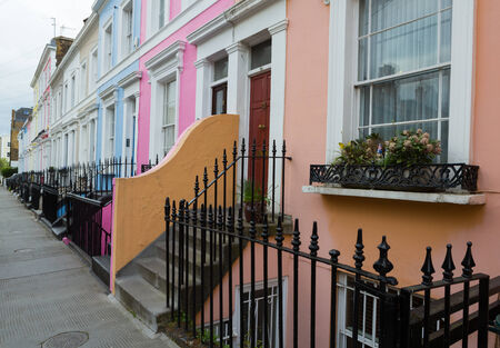 A street of colorful houses off of Portobello Road in London, England photo
