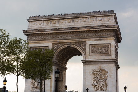 elysees: Arc de Triomphe in Paris, France shot from the Champs Elysees.