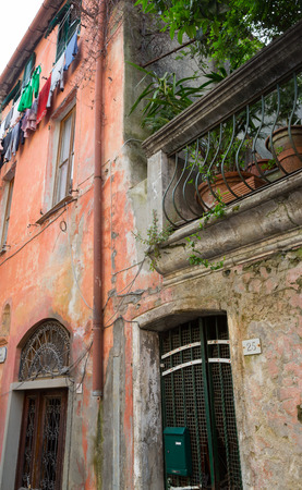 Colorful buildings in Monterosso in Cinque Terre, Italy on an overcast day.